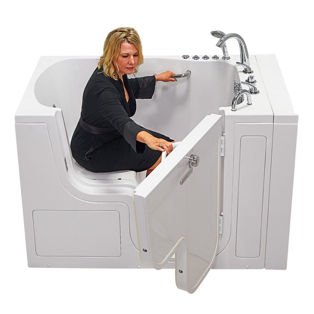 Women close the door of one Bariatric Walk-In Tub from Ella's Bubbles company.